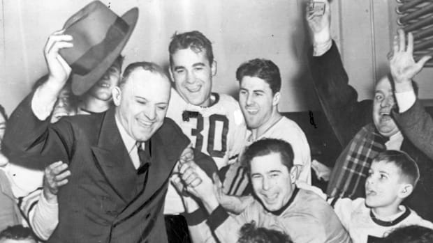 Chicago Bears coach George Halas (left) celebrates with his team following its 73-0 win over Washington in the 1940 NFL Championship game.
