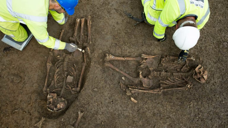 Ancient Grave Reveals Men's Legs Were Chopped Off at the Knee