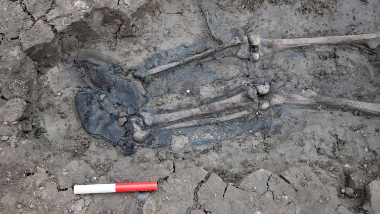 Why is This Medieval Skeleton Wearing Thigh-High Boots?