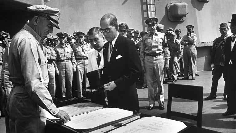 Japan surrenders, bringing an end to WWII