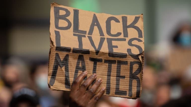 The hashtag #BlackLivesMatter first appears, sparking a movement