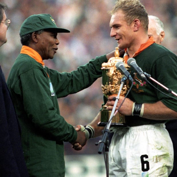 South Africa captain Francois Pienaar receives the William Webb Ellis Trophy from President Nelson Mandela after the home team defeated arch rival New Zealand in the 1995 Rugby Union World Cup in Johannesburg.