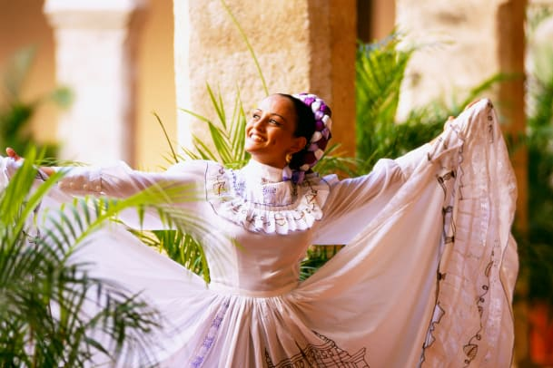 Smiling Dancer In Traditional Mexican Dress