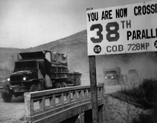 Military Trucks Crossing The 38th Parallel In Korea