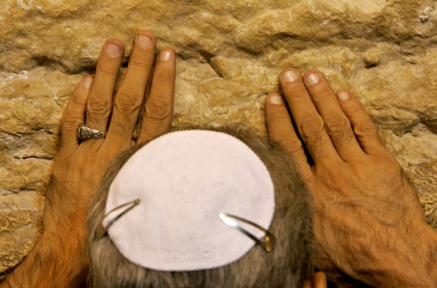 An Israeli Jew Prays During Morning Prayers At The Western Wall Judaisms Holiest Site In Jerusalem
