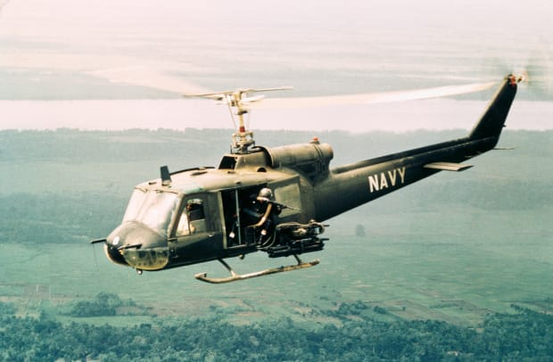 American Gunners Firing From Helicopter In Vietnam 3