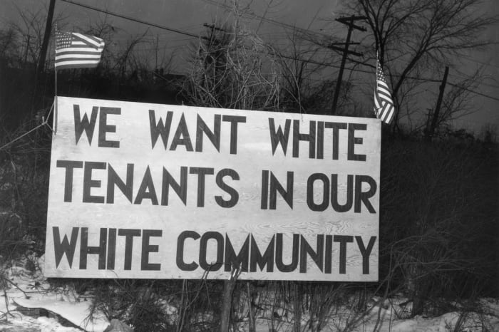 """A sign placed in front of the Sojourner Truth housing project reads: """"We want white tenants in our white community,"""" in Detroit, Michigan, 1942."""