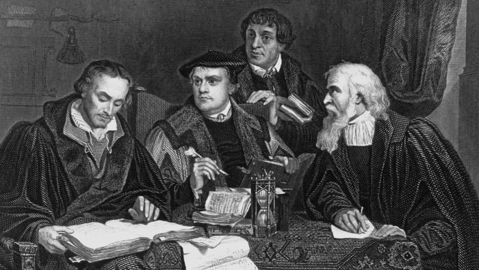 German theologian and reformer Martin Luther, seated center, with other German reformers Melancthon, Pomeranus and Cruciger.