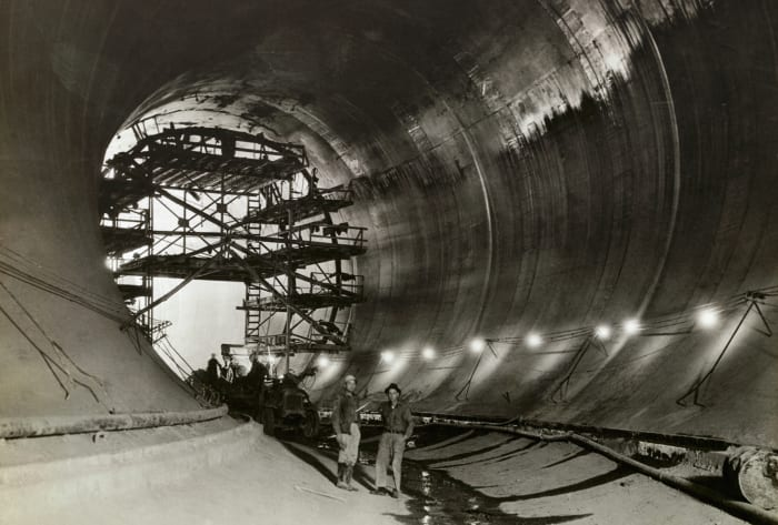View inside one of the50-foot-highHoover Dam concrete tunnels. This photo shows the grouting process of in operation in Diversion Tunnel No. 4,through which the Colorado River will be diverted.