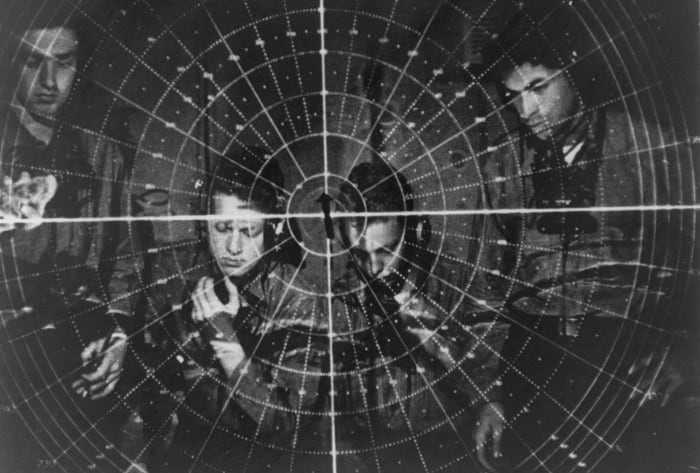 Personnel equipped with a radar telescope during World War II.