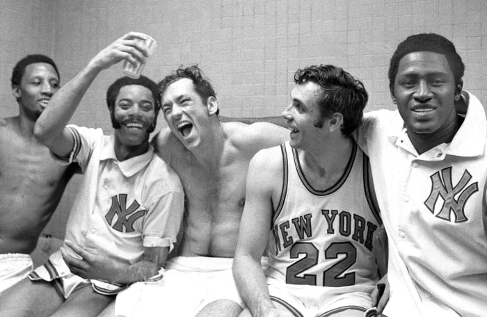 UNITED STATES - APRIL 20: The five New York Knicks - Dick Barnett, Walt Frasier, Bill Bradley, Dave DeBusschere and Willis Reed (left to right) - rejoice in the locker room after winning their fifth playoff game against the Milwaukee Bucks, by an unbalanced score of 132-96, and with it their first National Basketball Association Eastern Conference title since 1953. The Knicks then beat the Los Angeles Lakers in the final for their first-ever NBA championship.  (Photo by Dan Farrell / NY Daily News Archive via Getty Images