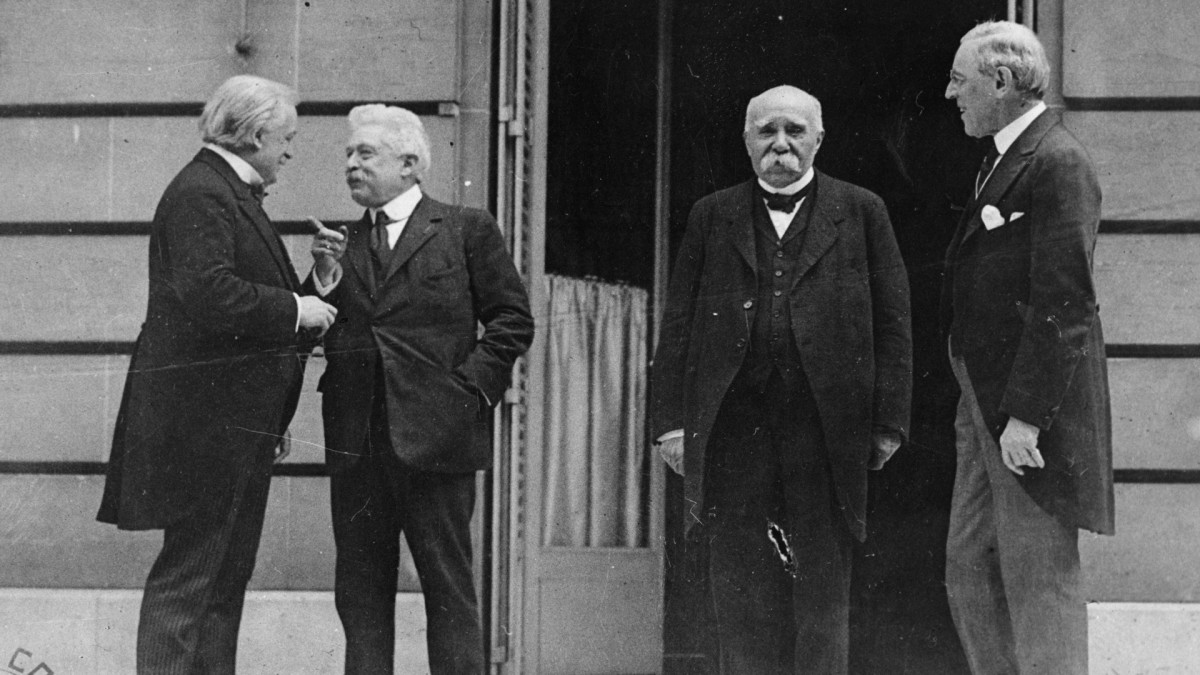 Council of Four at the WWI Paris peace conference, May 27, 1919 (L - R) Great Britain Prime Minister David Lloyd George, Italian Premier Vittorio Orlando, French Premier Georges Clemenceau, U.S. President Woodrow Wilson. The treaty signed at the conference saddled Germany with billions of dollars in reparations.