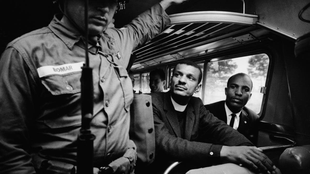 A National Guardsmen on a bus with two Freedom Riders, May 1961. (Credit: Paul Schutzer/The LIFE Picture Collection/Getty Images)