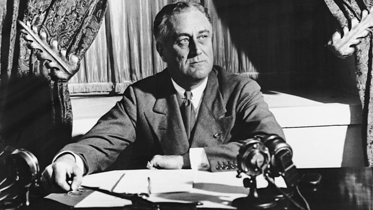 "Franklin Roosevelt preparing for his first ""fireside chat"" in which he explained the measures he was taking to reform the nation's banking system. (Credit: Corbis/Getty Images)"