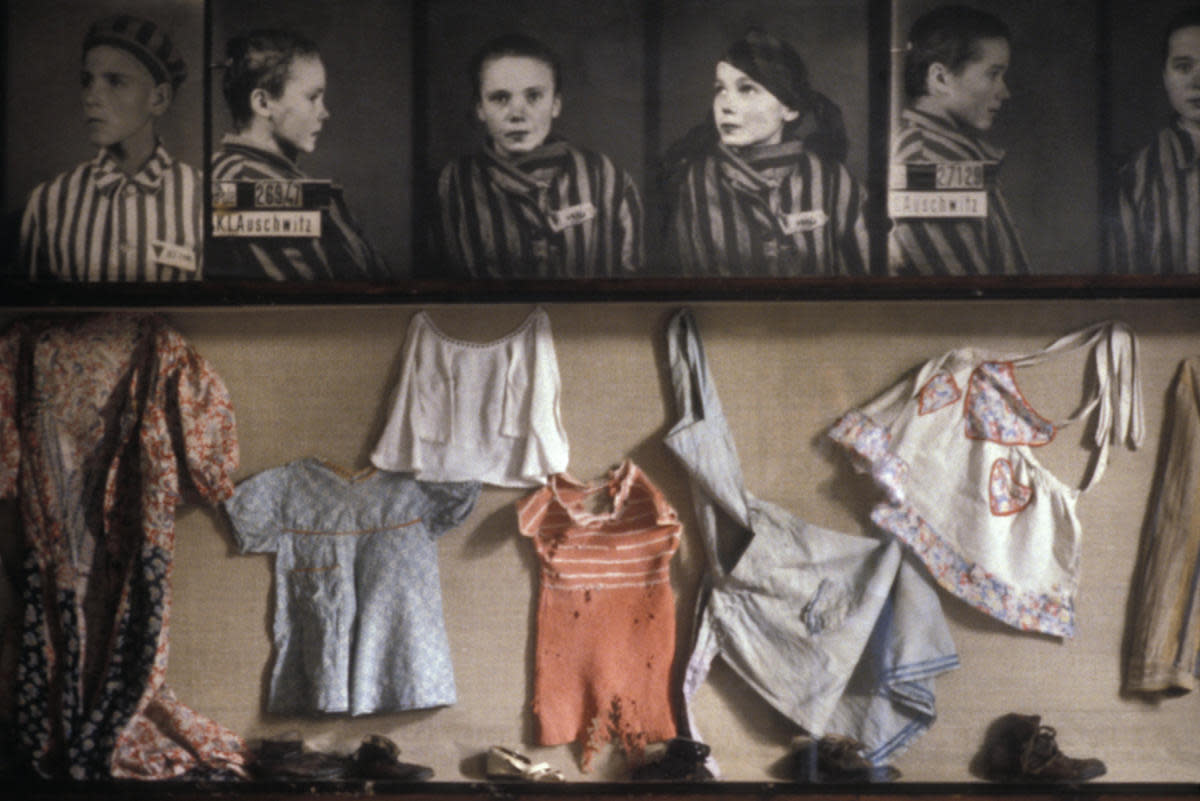 Photos of children and items of clothing found at Auschwitz. (Credit: François Lochon/Gamma-Rapho/Getty Images)
