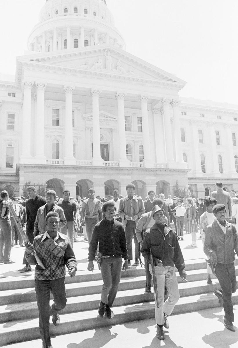 Armed members of the Black Panther Party leaving the Capitol in Sacramento, California, May 2, 1967. (Credit: AP Photo)
