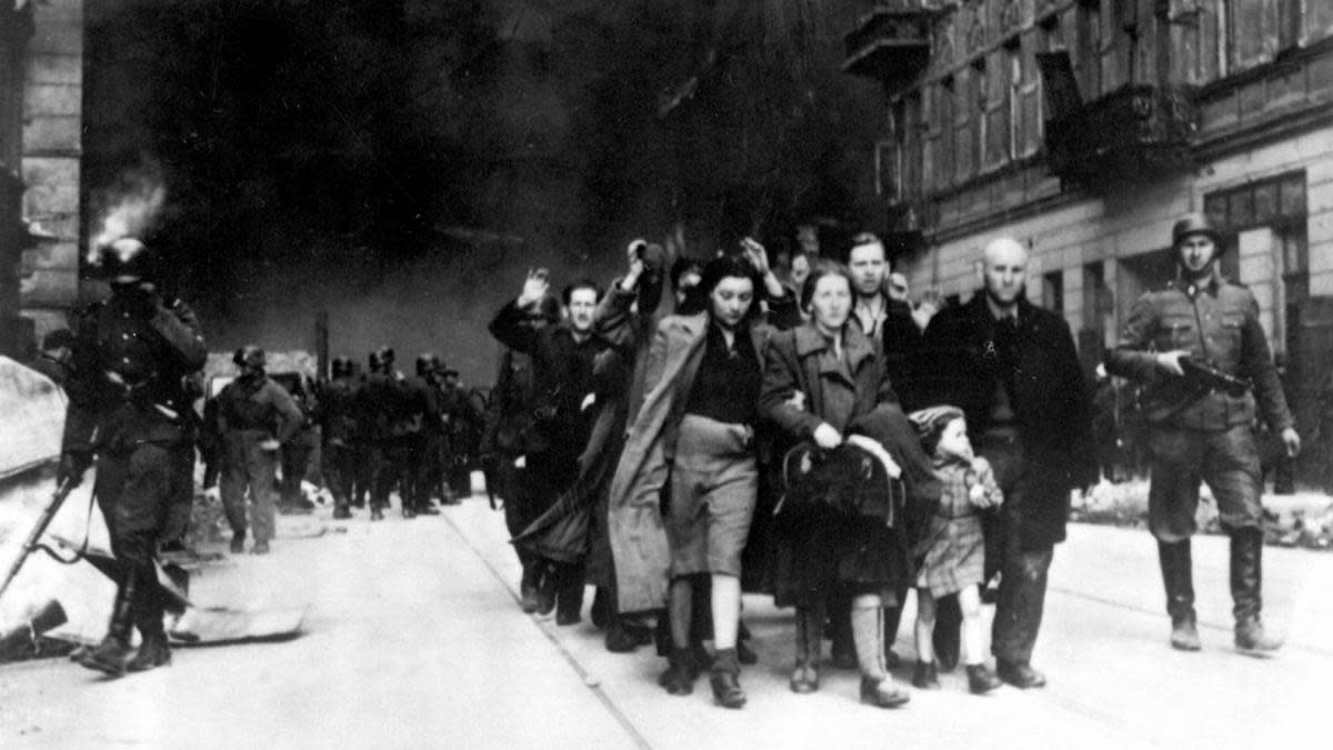 Jews being led for deportation in the Warsaw Ghetto, during the Warsaw Ghetto Uprising in 1943. (Credit: Universal History Archive/UIG via Getty Images)