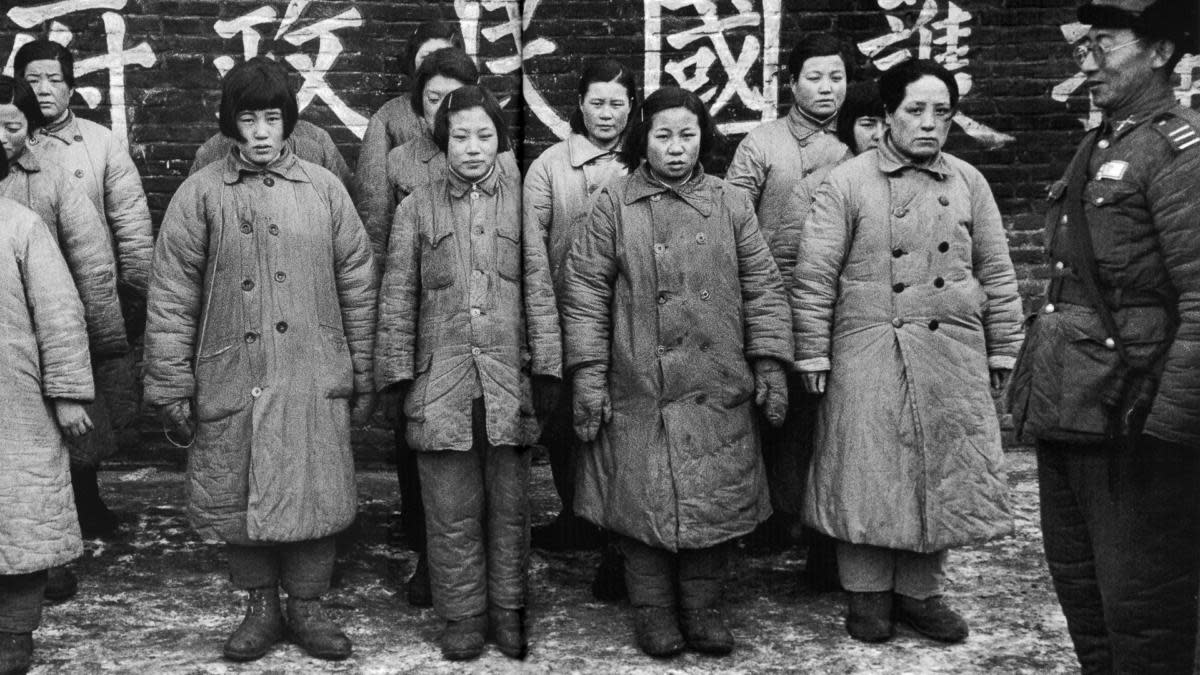 "A Nationalist officer guarding women prisoners said to be ""comfort girls""  used by the Communists, 1948."
