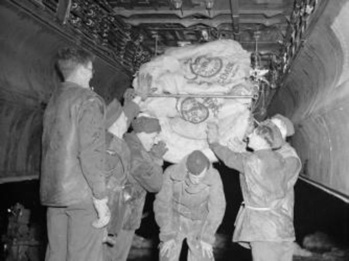 A crew loading food into the bomb bay of an RAF Lancaster during Operation Manna.