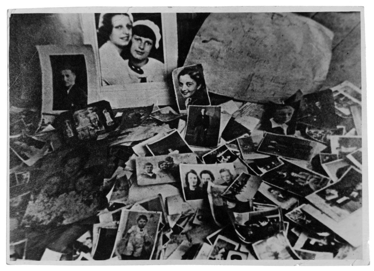 Some photos found amidst personal belongings of victims of the Majdanek concentration camp. (Credit: Sovfoto/UIG via Getty Images)