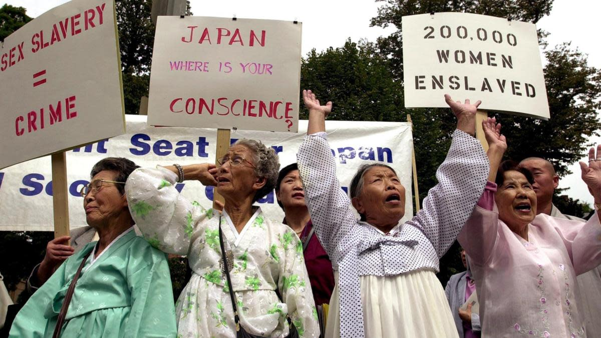 A group of women, who survived being forced into brothels set up by the Japanese military during World War II, protesting in front of the Japanese Embassy in 2000, demanding an apology for their enslavement. (Credit: Joyce Naltchayan/AFP/Getty Images)