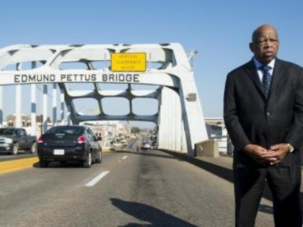 "Rep. John Lewis stand on the Edmund Pettus Bridge in Selma, Alabama, nearly 50 years after the brutal events of ""Bloody Sunday."""
