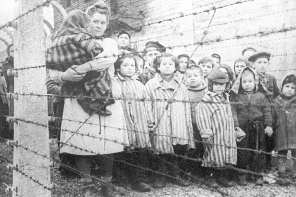 A nurse and children during the liberation of Auschwitz, 1945. (Credidt: TASS/Getty Images)