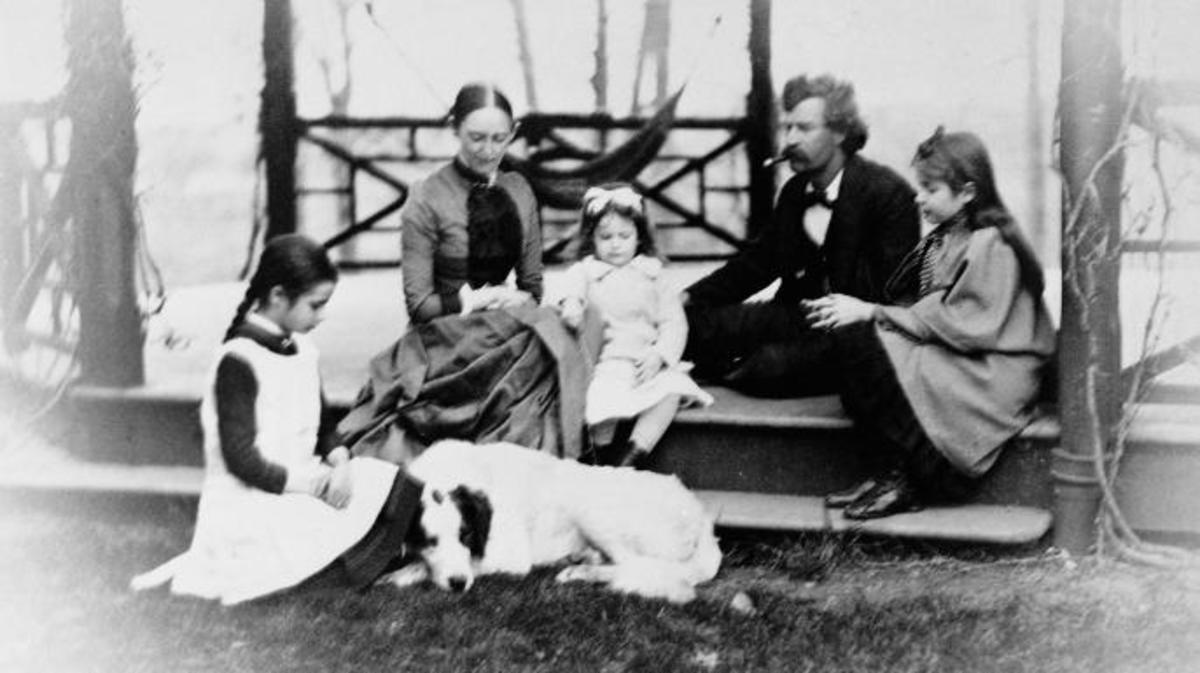 Mark Twain with family, circa 1865. (Credit: Fotosearch/Getty Images).