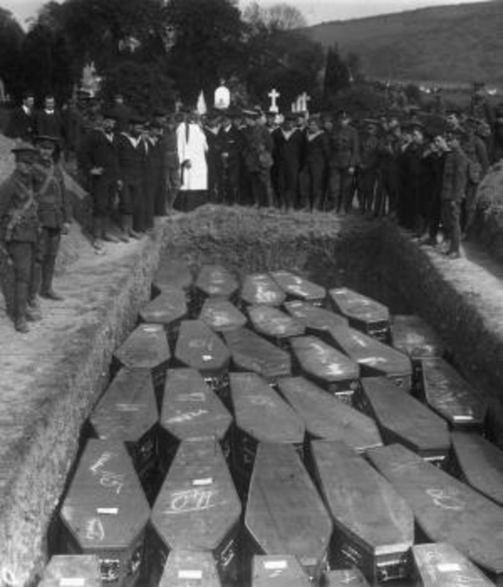 Servicemen attend a mass funeral in Cobh, County Cork, Ireland for victims of the Lusitania disaster. (Credit: Topical Press Agency/Getty Images)
