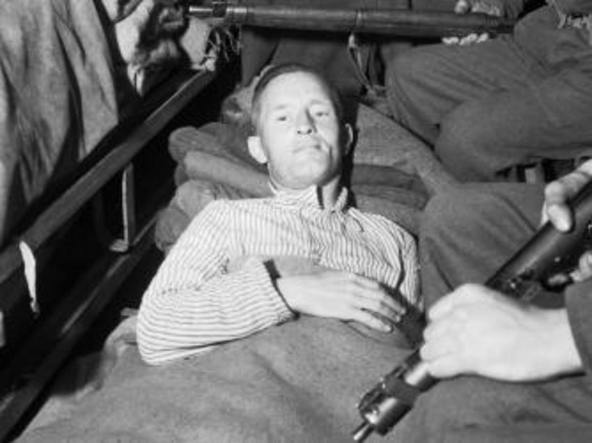"William Joyce, aka ""Lord Haw-Haw,"" under arrest in 1945."