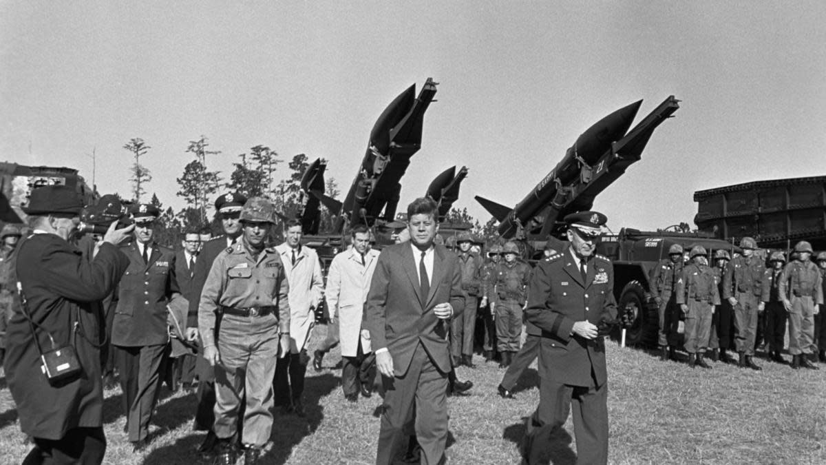 President Kennedy with U.S. Army officials during the Cuban Missile Crisis, 1962. (Credit: Corbis via Getty Images)