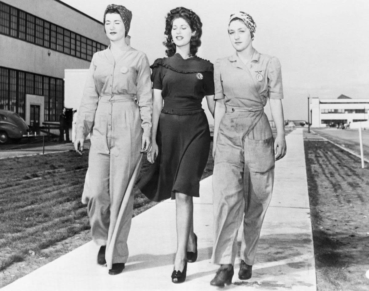 Naomi Parker, Ada Parker, and Frances Johnson representing war work fashion at the Alameda U.S. Naval Air Station. (Credit: Bettmann Archive/Getty Images)