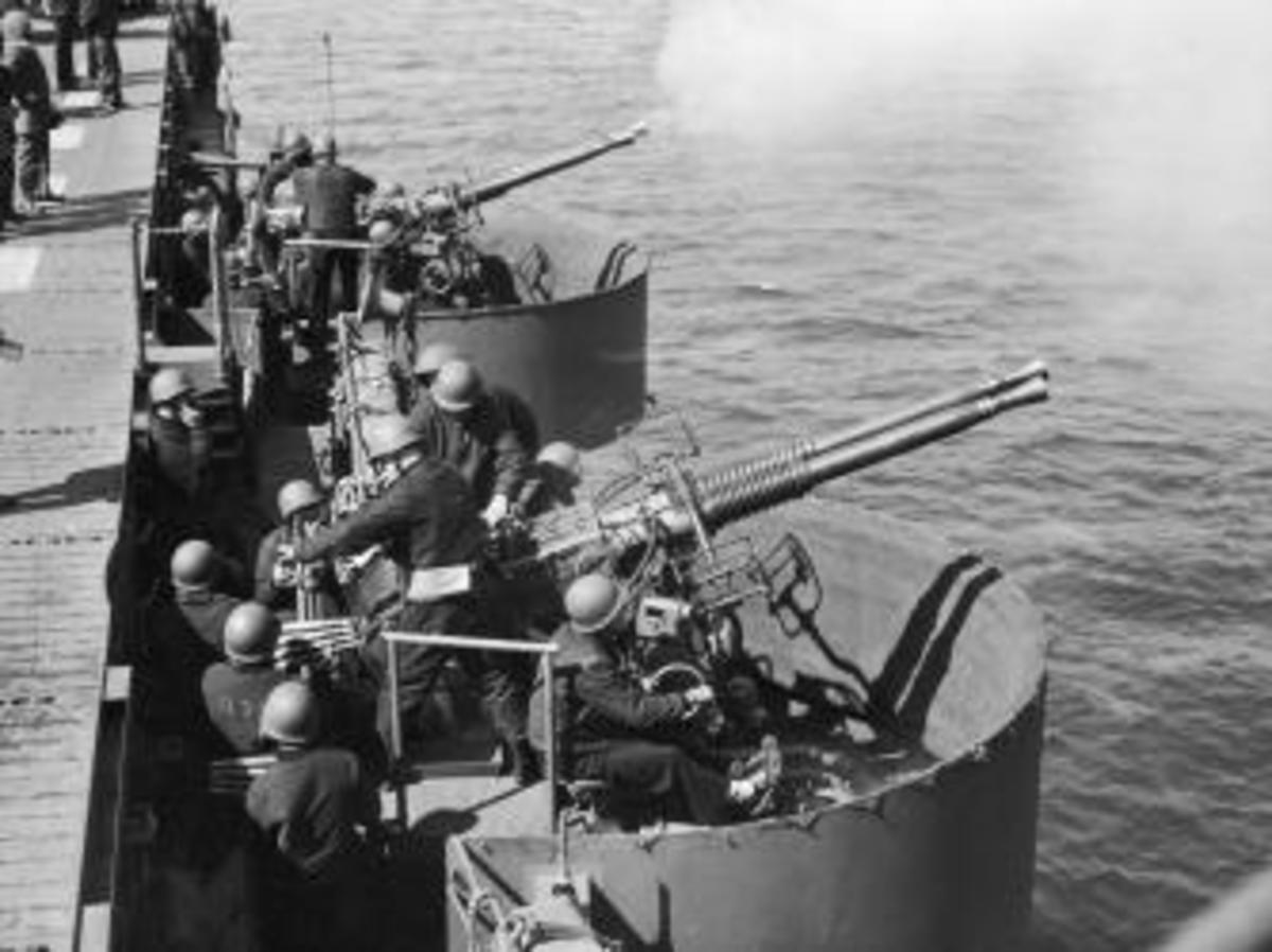 U.S. naval officers fire antiaircraft guns on the deck of USS Independence during World War II. (Credit: Hulton Archive/Getty Images)