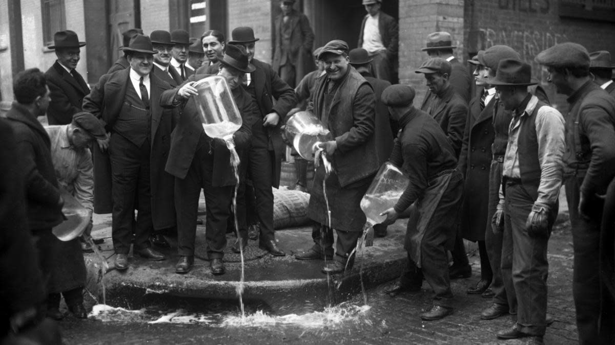 New York City Liquor Agent Izzy Einstein dumping liquor into the gutter during prohibition. (Credit: Daily News/NY Daily News via Getty Images)