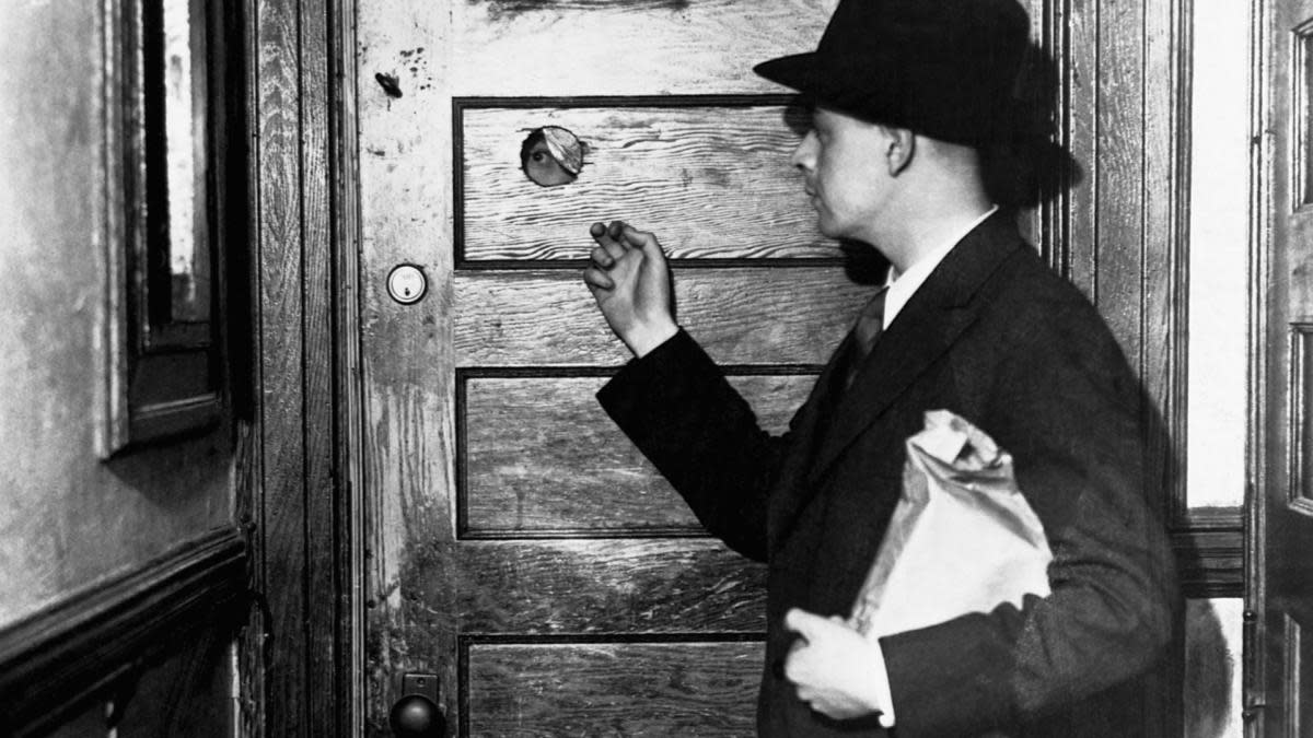 A peep hole in the door of a speakeasy during Prohibition. (Credit: Bettmann Archive/Getty Images)