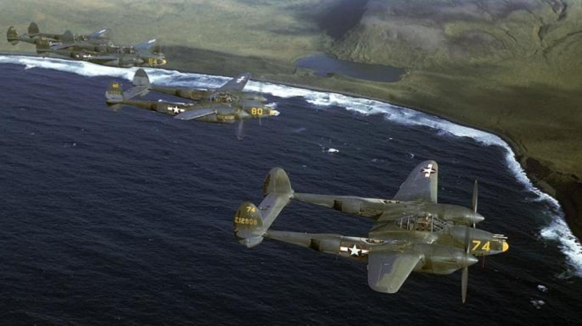 A squadron of American P-38 fighters in flight over the Aleutian Islands.