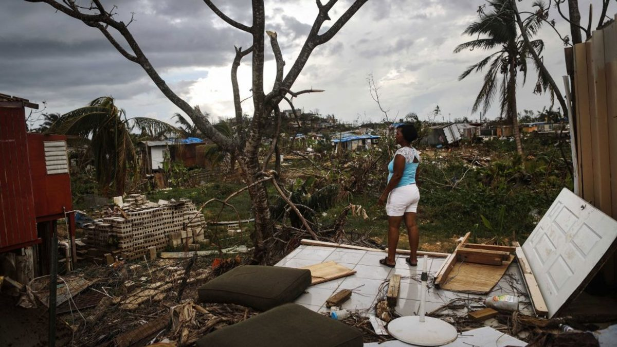 Resident Mirian Medina stands on her property about two weeks after Hurricane Maria, a category 4 storm, swept through the island on October 5, 2017 in San Isidro, Puerto Rico. (Credit: Mario Tama/Getty Images)