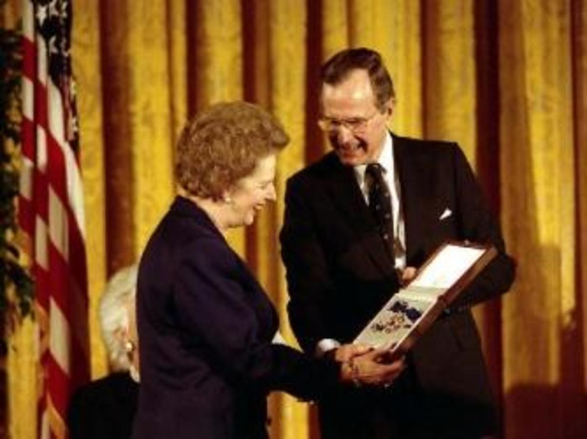 Receiving Presidential Medal Of Freedom. (Credit: George Bush Presidential Library)