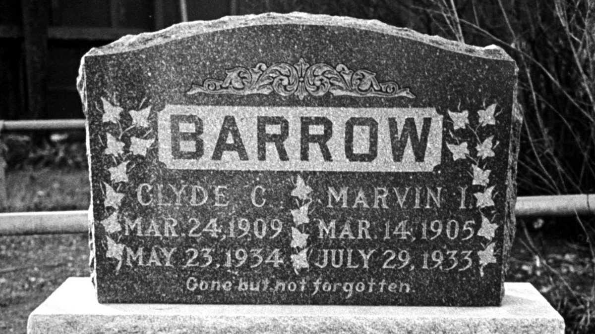 "The tombstone of Clyde Barrow and his brother Marvin, better known by his nickname ""Buck."" (Credit: Carl Mydans/The LIFE Picture Collection/Getty Images)"