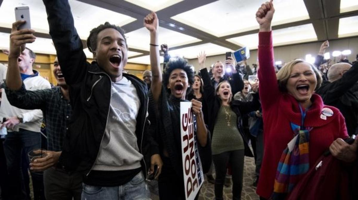 Supporters of Alabama Democrat Doug Jones celebrate his victory over Judge Roy Moore at the Sheraton in Birmingham, Alabama, on Tuesday, Dec. 12, 2017. Jones faced off against Judge Roy Moore in a special election for Jeff Sessions' seat in the U.S. Senate. (Credit: Bill Clark/CQ Roll Call/Getty Images)