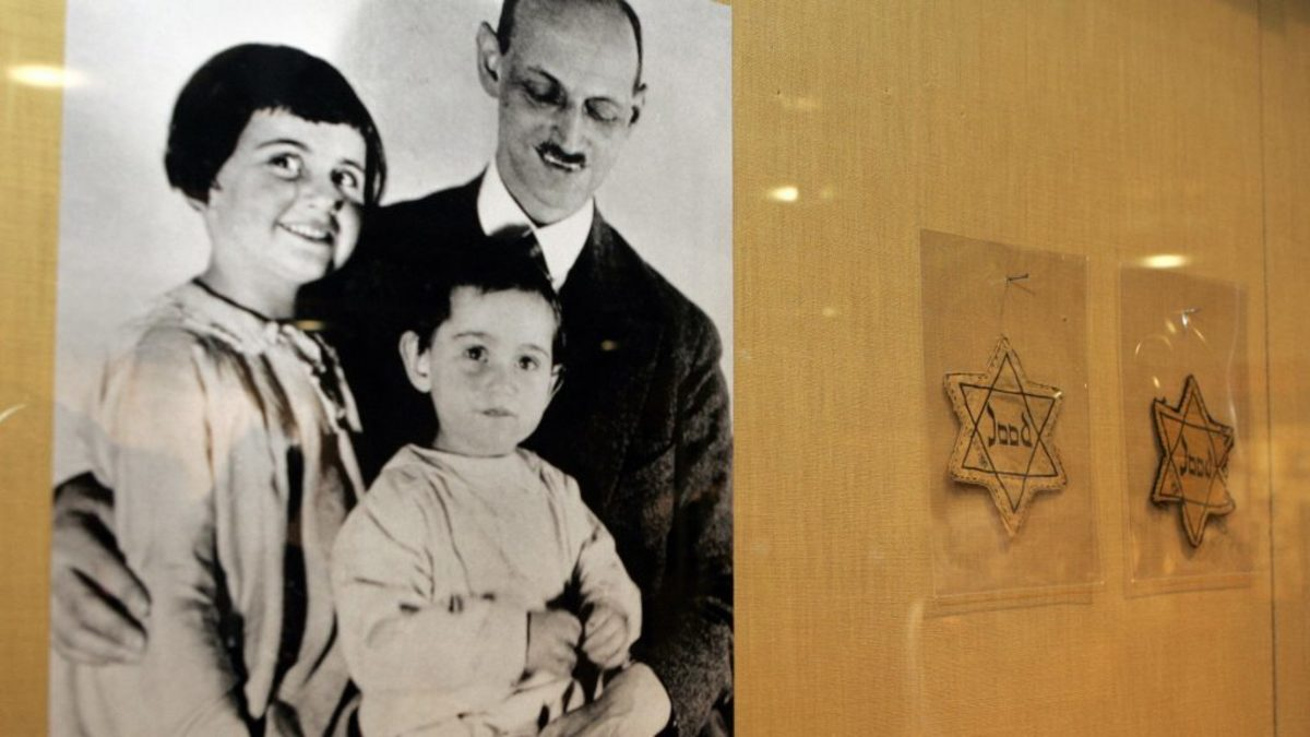 A photograph (left) of Otto Frank with his daughters Anne and Margaret; at right, yellow stars worn by Dutch Jews being displayed in New York, 2007. (Credit: Stan Honda/AFP/Getty Images)