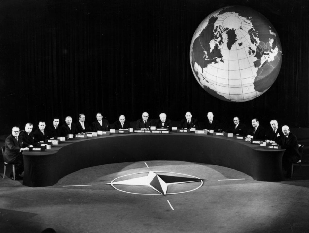 Delegates at the 1957 NATO (North Atlantic Treaty Organization) conference at Paris. From left, Van Acker (Belgium), Dieffenbaker (Canada), Gaillard (France), Adenauer (Germany), Hansen (Denmark), Karamanlis (Greece), Jonasson (Iceland), Zoli (Italy), Spaak (NATO Secretary-General), Bech (Honorary Chairman), Hommel (Luxembourg), Luns (Netherlands), Gerhardsen (Norway), Cunha (Portugal), Menderes (Turkey), Harold MacMillan (Britain) and Dwight D Eisenhower (USA). (Photo by Keystone/Getty Images)