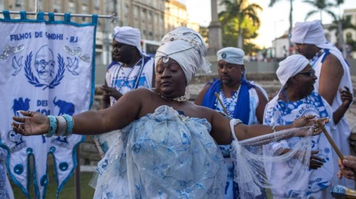 People celebrate after Valongo Wharf was added to the list of UNESCO World Heritage sites, in Rio de Janeiro, Brazil. The committee of the UN cultural body, meeting in Krakow, Poland, said Valongo was a reminder of an estimated 900,000 African slaves who were brought there by traders starting in 1811.(Credit: Maruo Pimentel/AFP/Getty Images)