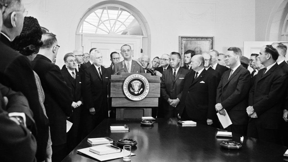President Johnson personally urging key Congressmen to revamp U.S. immigration laws. Michael A. Feighan appears here left of Johnson. (Credit: Bettmann Archive/Getty Images)