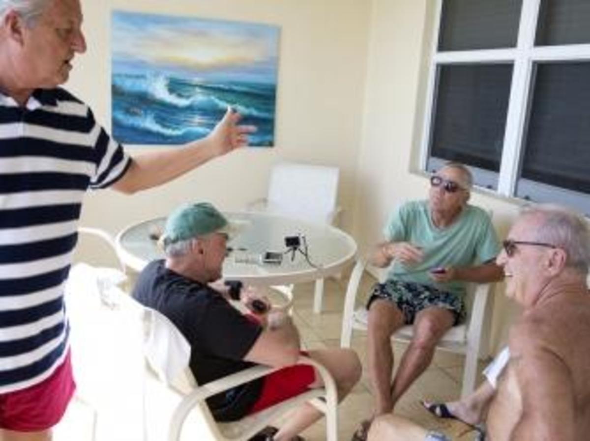 From the left, Bob Falk, Tom Hanks, Bob DeVenezia and Dennis Puleo sit and share stories on the balcony of the condo the group rented for a few days on Cinnamon Beach. (Credit: Naples Daily News)