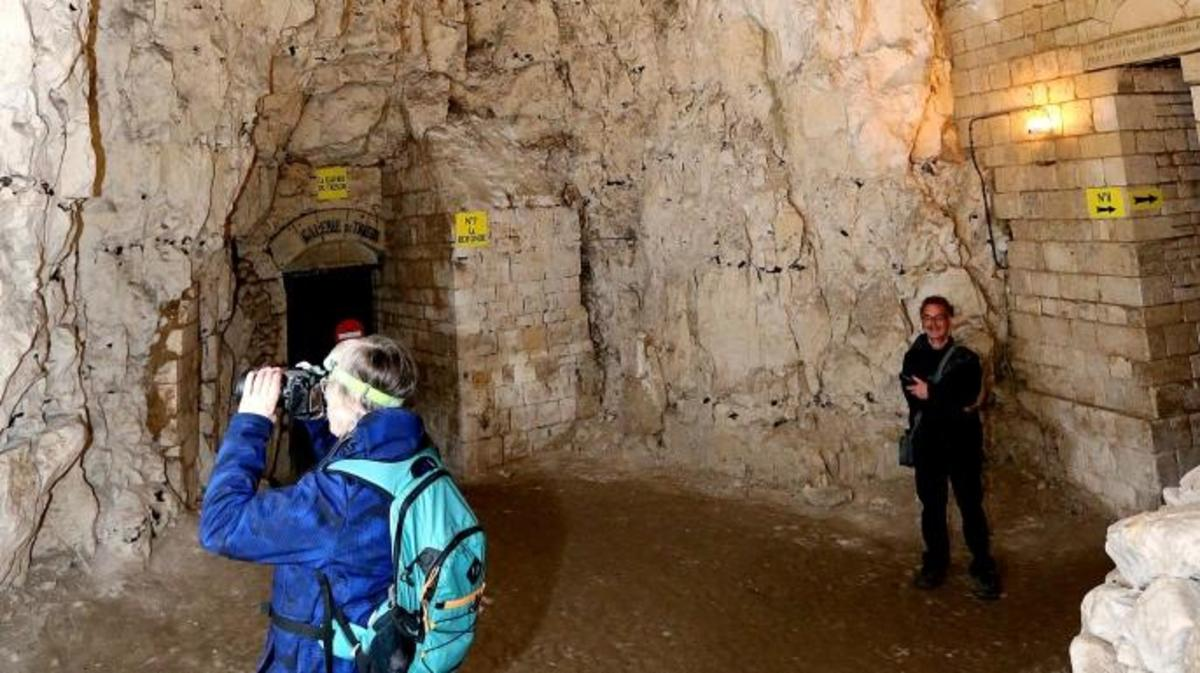 A tourist takes a picture inside the Naours underground city. (Credit: FRANCOIS NASCIMBENI/AFP/Getty Images)
