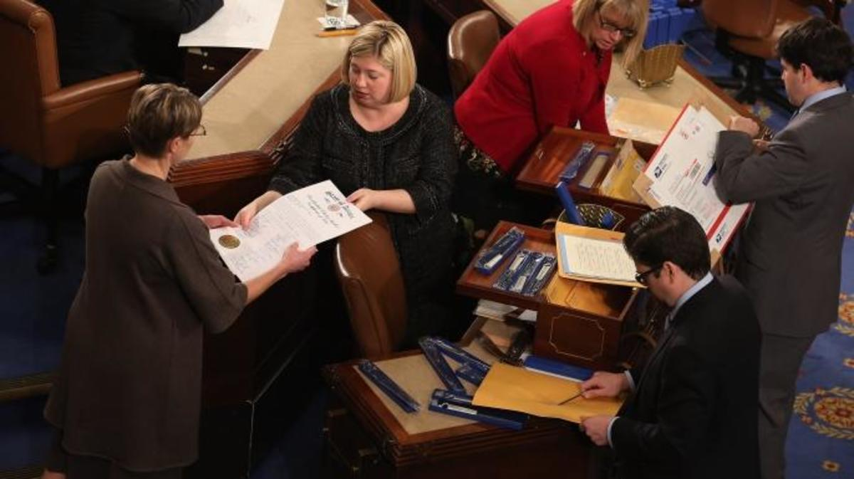 Congressional clerks help unseal and organize the Electoral College.  (Credit: Chip Somodevilla/Getty Images)