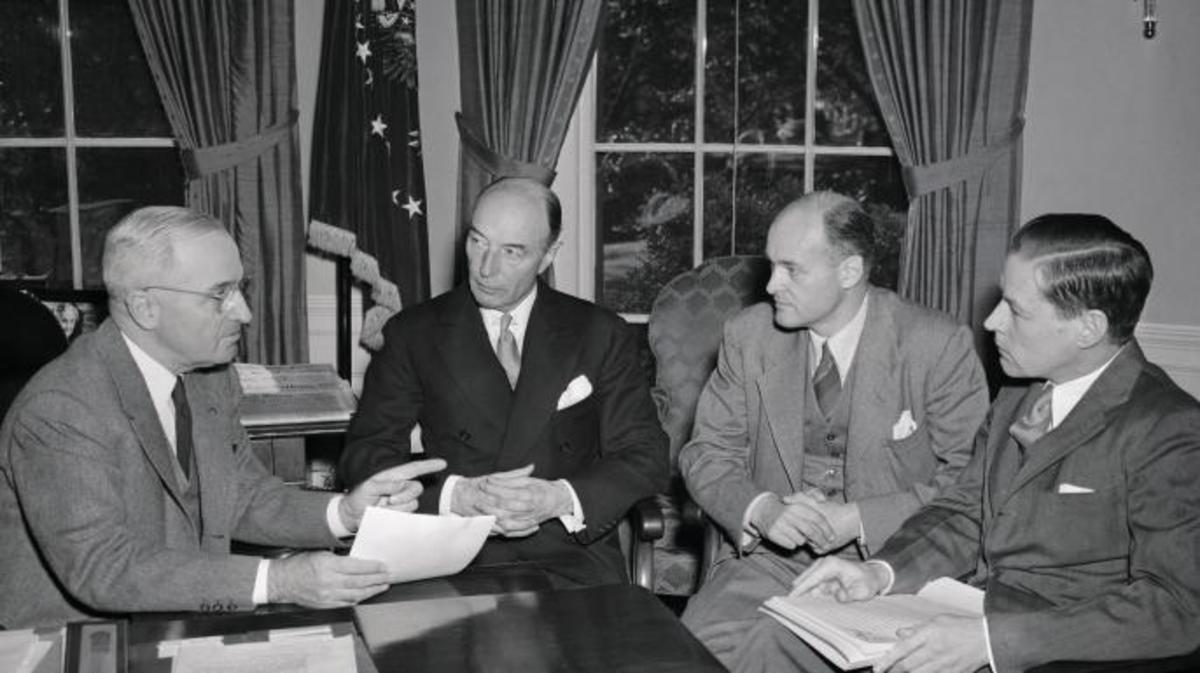 President Truman with Undersecretary of State Robert Lovett; George F. Kennan, Director of the Policy Planning Staff of the State Department; Charles E. Bohlen, special assistant to Secretary Marshall. (Credit: Credit: Bettmann / Getty Images)