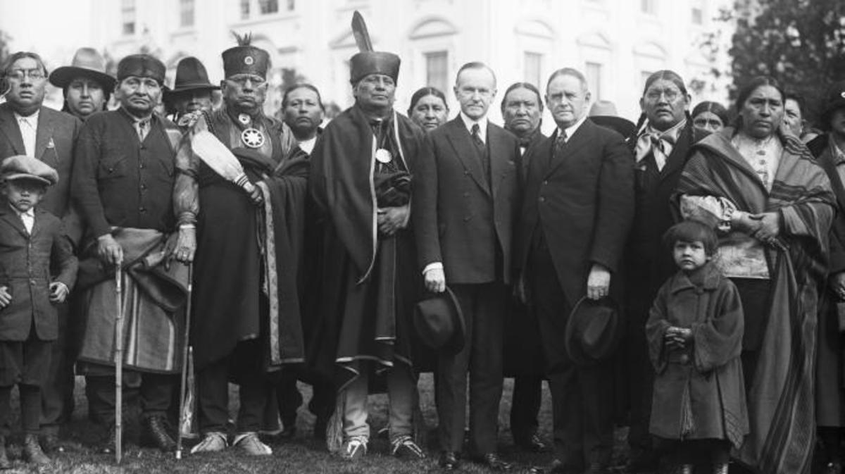 Osage Indians in Washington D.C., with President Coolidge. (Credit: Bettmann / Getty Images)