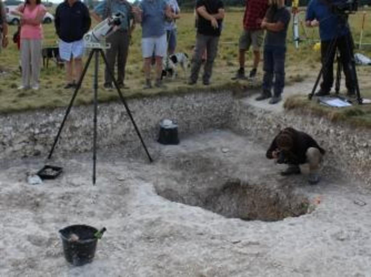 The Ludwig Boltzmann Institute recording the westernmost posthole. (Credit: National Trust)